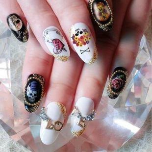 Нарощенные ногти, маникюр на хэллоуин с черепами и розами