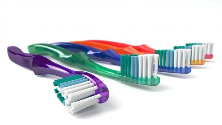 Удаление катышков с помощью зубной щетки